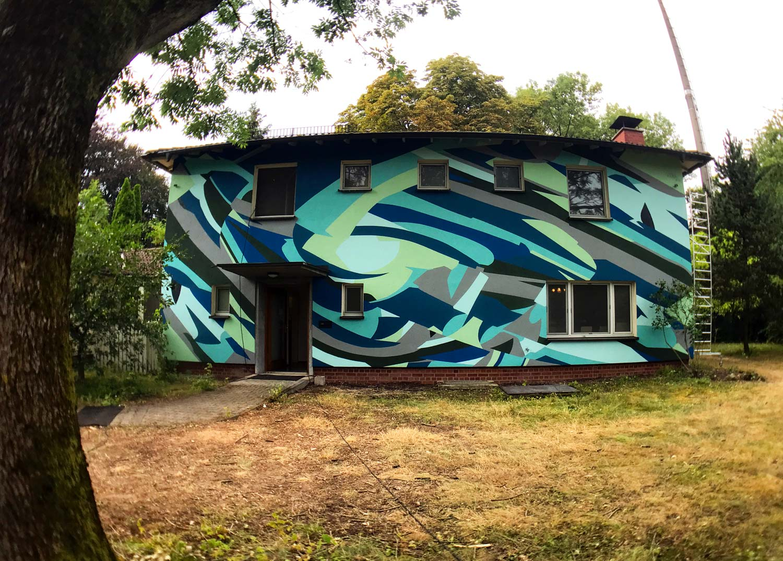 Bemalte Hauswand von Kera Christian Hinz auf dem Metropolink Festival, Heidelberg
